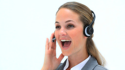 Smiling woman wearing a headset Stock Video Footage