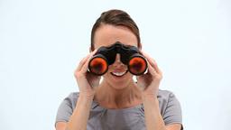 Happy woman looking through binoculars Footage