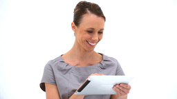 Smiling woman using a tablet pc Stock Video Footage