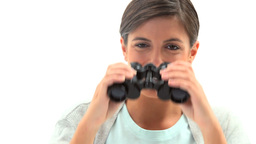 Woman looking through a binoculars Stock Video Footage