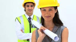 Business people wearing safety helmet Stock Video Footage