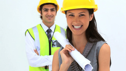 Business people wearing safety helmet Stock Video Footage