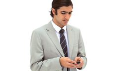 Businessman texting on his mobile phone Footage