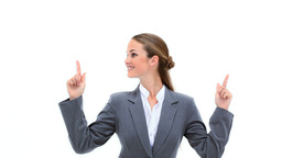 Blonde businesswoman pointing her fingers up Footage