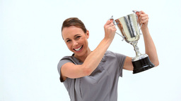 Businesswoman Brandishing A Trophy stock footage