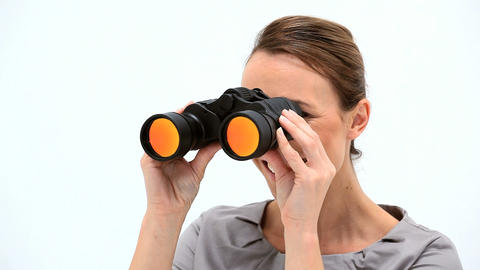 Smiling businesswoman looking through binoculars Footage