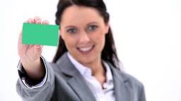 Smiling secretary holding a business card Stock Video Footage