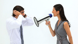 Woman shouting in a megaphone Stock Video Footage