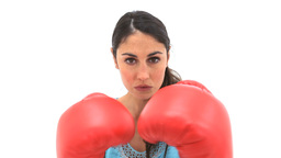 Serious woman using boxing gloves Stock Video Footage
