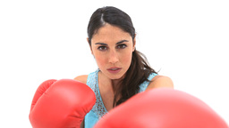 Serious woman using boxing gloves Footage