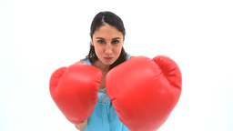 Brunette woman boxing with red gloves Stock Video Footage