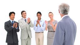 Boss being congratulated by coworkers Stock Video Footage