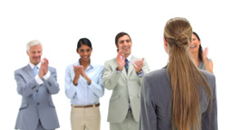 Young businesswoman being congratulated Stock Video Footage