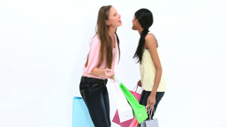 Friends kissing while holding shopping bags Stock Video Footage