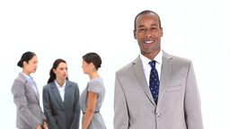 Smiling businessman standing in front of colleague Footage