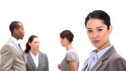 Businesswoman standing with coworkers behind her Footage