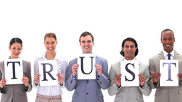 Business people holding boards with the word TRUST Footage