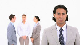 A businessman standing in the foreground Stock Video Footage