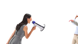Businesswoman using a megaphone to shout at cowork Stock Video Footage