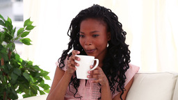 Smiling woman drinking a tea Stock Video Footage