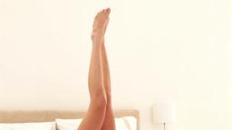 Brunette rubbing her legs Stock Video Footage