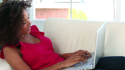 Young woman typing on a laptop Stock Video Footage