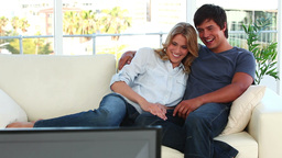 Smiling couple sitting on the sofa Stock Video Footage