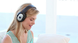 Blonde woman listening to music in front of her la Stock Video Footage