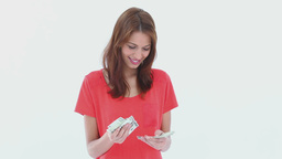 Brunette haired woman counting dollars Footage