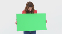 Beautiful woman holding a blank poster Footage