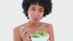 Black haired woman eating salad Live Action