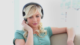 Young woman wearing headphones Stock Video Footage