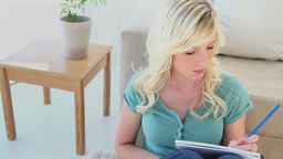 Young blonde woman writing Stock Video Footage