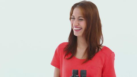 Laughing brunette haired looking through binocular Footage