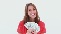 Laughing brunette haired woman holding US dollars Footage