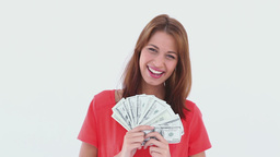 Laughing brunette haired woman holding US dollars Stock Video Footage