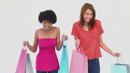 Two women dancing with shopping bags Stock Video Footage