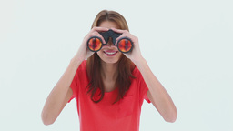 Brunette haired woman looking through binoculars Stock Video Footage