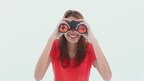 Brunette haired woman looking through binoculars Footage