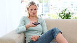 Blonde woman using a remote control Footage