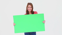 Brunette haired woman holding a blank poster Footage