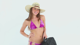 Woman in bikini holding a suitcase Stock Video Footage