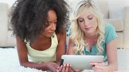 Young women using an ebook Stock Video Footage
