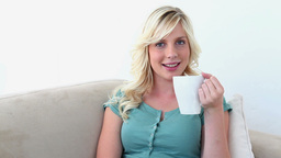 Blonde haired woman drinking coffee Footage