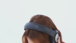 Brunette haired woman dancing with headphones Footage