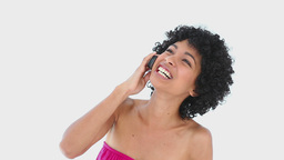 Laughing woman with frizzy hair on the phone Footage