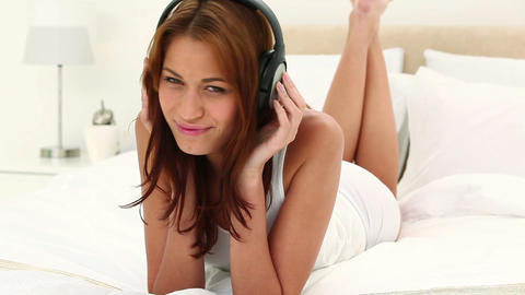 Brunette haired woman listening to music Footage