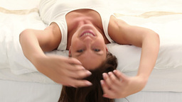 Beautiful woman lying on her bed Stock Video Footage