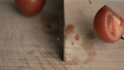 Tomato in super slow motion being cut Footage