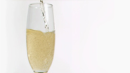 Champagne in super slow motion filling a glass Footage